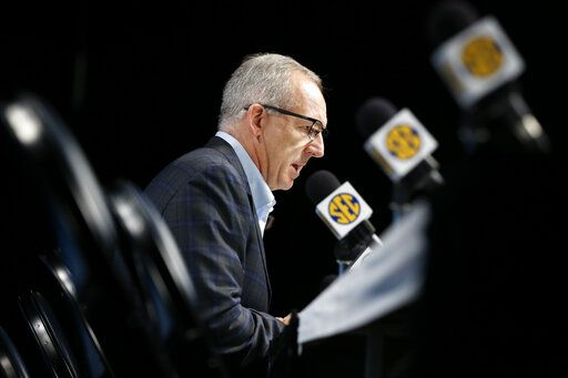 FILE - In this March 12, 2020, file photo,  Greg Sankey, commissioner of the Southeastern Conference, talks about the decision to cancel the remaining games in the SEC NCAA college basketball tournament, in Nashville, Tenn.  College sports leaders have repeatedly said there can be no college sports without campuses being open to students. And those decisions will be made with guidance from state and local public health and government officials.