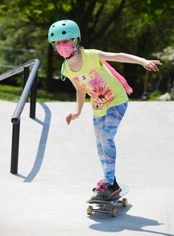 Celia Aronoff, 9, of Vernon Hills rides her skateboard during the opening weekend of the Vernon Hills Park District's new skate park near the Sullivan Community Center Saturday.