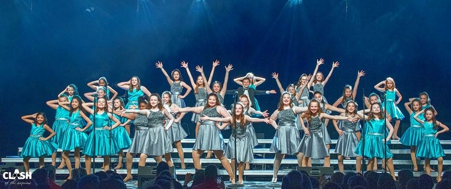 Show choir members with the new Naperville nonprofit Road Show Inc. perform during the Clash of the Sequins competition early this year at Naperville North High School. Choir members this summer are participating in virtual classes to sharpen their singing, dancing and acting skills.