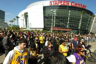 FILE - In this Feb. 24 2020, file photo, fans leave the Staples Center after a public memorial for former Los Angeles Lakers star Kobe Bryant and his daughter, Gianna, in Los Angeles. Staple Center is one of the possible locations the NHL has zeroed in on to host playoff games if it can return amid the coronavirus pandemic. The league will ultimately decide on two or three locations for games, with government regulations, testing and COVID-19 frequency among the factors for the decision that should be coming within the next three to four weeks. (AP Photo/Ringo H.W. Chiu, File)