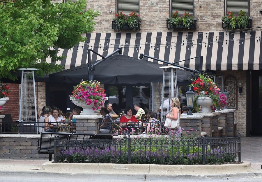 Outdoor eating areas, like this one in downtown Libertyville, will be allowed as of Friday as Phase 3 of Restore Illinois begins. Libertyville, Vernon Hills, Mundelein and other communities are making special accommodations to permit outdoor dining.