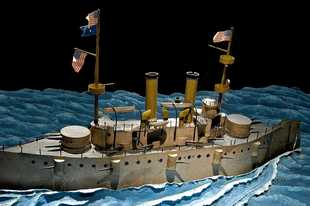 In 1898, Edward Amet of Waukegan, made this model of the USS Olympia for a series of films on the Spanish-American War. This model is one of the earliest known special effects props used in motion pictures.