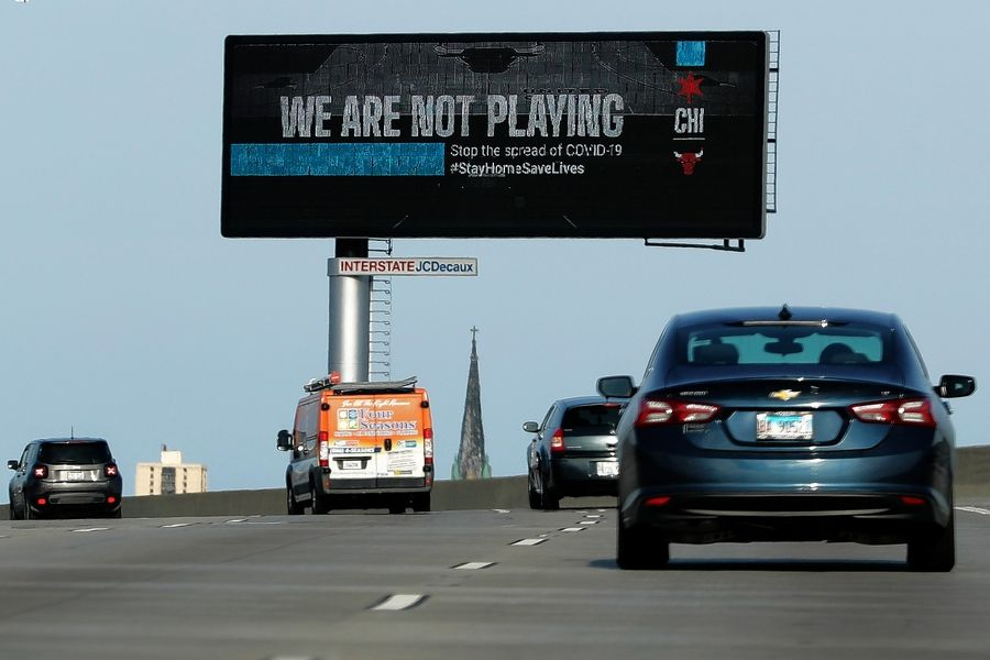 A billboard on I-55 Dan Ryan highway delivers a message from the Chicago Bulls basketball team during the coronavirus pandemic in Chicago, Friday, April 10, 2020.