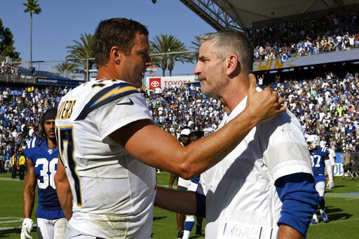 FILE - In this Sept. 8, 2019, file photo, Los Angeles Chargers quarterback Philip Rivers, left, greets Indianapolis Colts head coach Frank Reich after an NFL football game in Carson, Calif. The Indianapolis Colts bet big on 38-year-old Philip Rivers. They're hoping the $25 million investment in a new starting quarterback pays off with a playoff appearance and perhaps Super Bowl run. Colts coach Frank Reich insists he's seen no physical decline in the eight-time Pro Bowler.