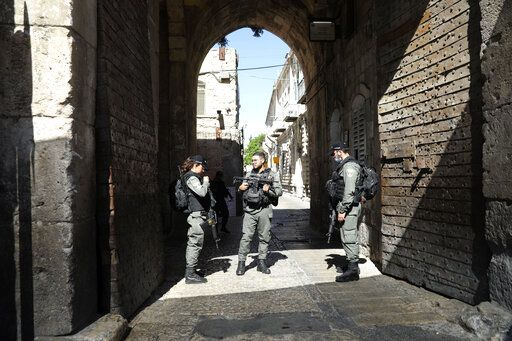 Israeli police officers secure the area of Lion's gate in Jerusalem's Old City, Saturday, May 30, 2020. Israeli police shot dead a Palestinian near Jerusalem's Old City who they had suspected was carrying a weapon but turned out to be unarmed.