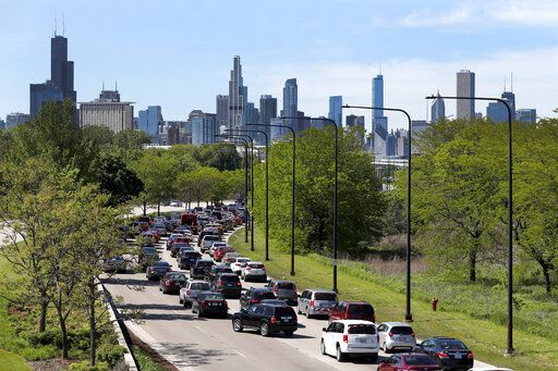 Motorists traveling northbound on Lake Shore Drive to downtown Chicago sit in stalled traffic Sunday, May 31, 2020, as police forced traffic off at the 31st Street exit, as part of a security perimeter around the downtown area.