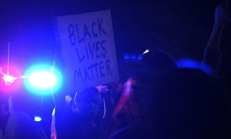 Several hundred people gathered for a protest Monday night outside the police station in Elgin.
