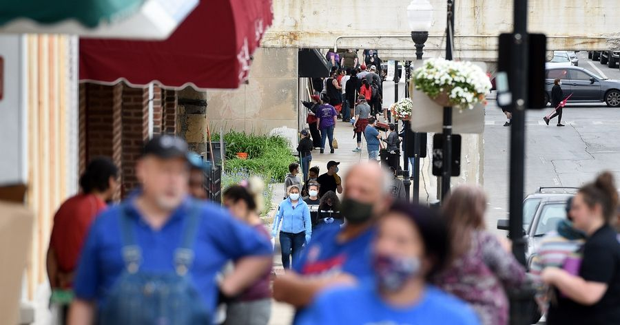 So many volunteers turned out Monday morning to help repair damage in downtown Aurora that some actually struggled to find something to clean up.