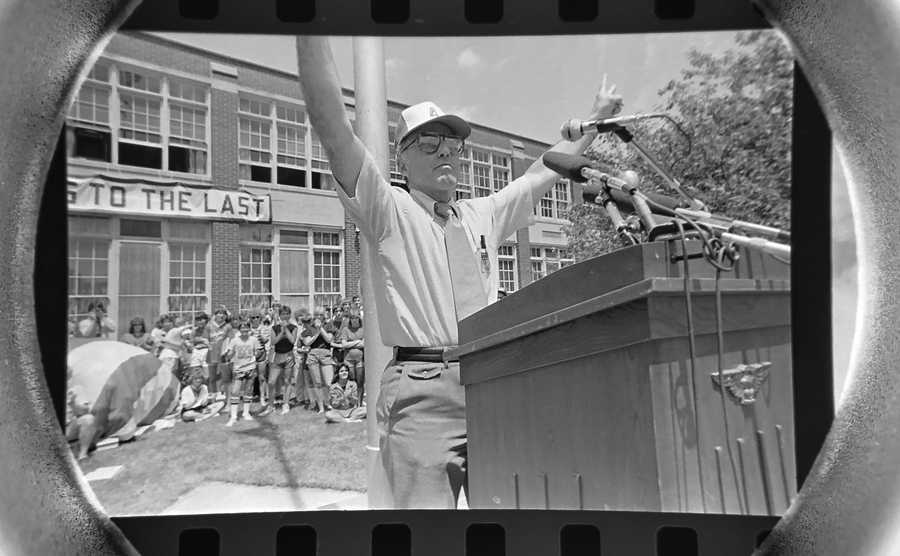 The Daily Herald Archives, Assignment # 71,836, Dave Tonge photo: On the very last day of Arlington High School on June 8, 1984, Athletic Director Russ Attis presides over the last bell and last flag lowering ceremony. In 1985 Christian Liberty Academy of Prospect Heights purchased the school and continues to operate from that location.