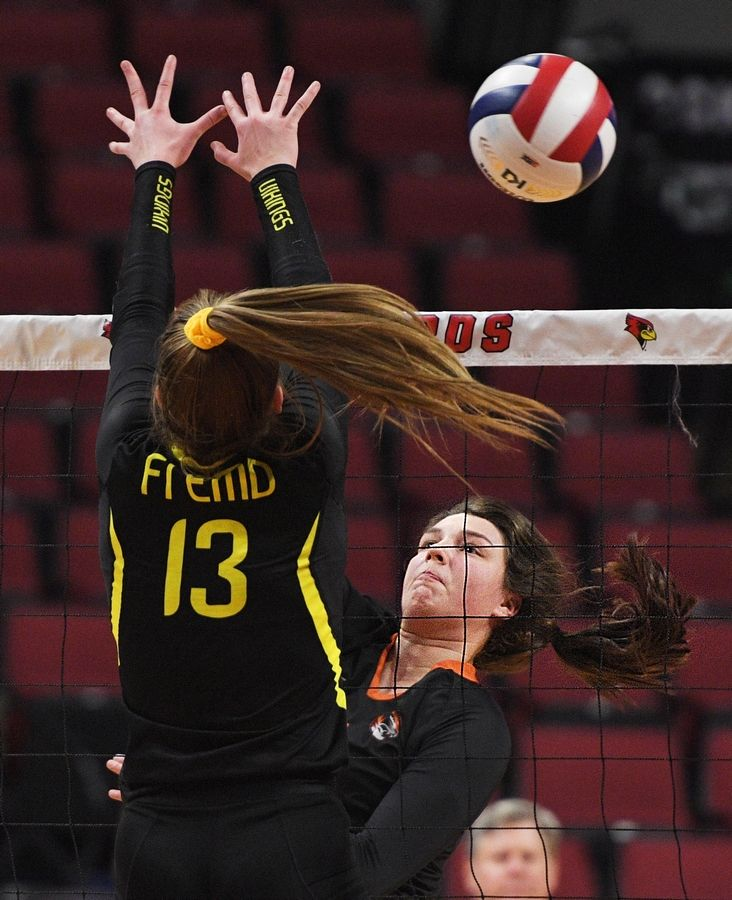 Wheaton Warrenville South's Annika Barron tries to hit past Fremd's Rylen Reid in the Class 4A girls volleyball state semifinal match at Illinois State University in Normal.