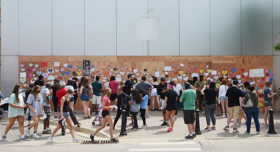 The Apple Store in downtown Naperville was among businesses decorated Wednesday with heart-shaped paper containing messages affirming the Black Lives Matter or promoting positivity.
