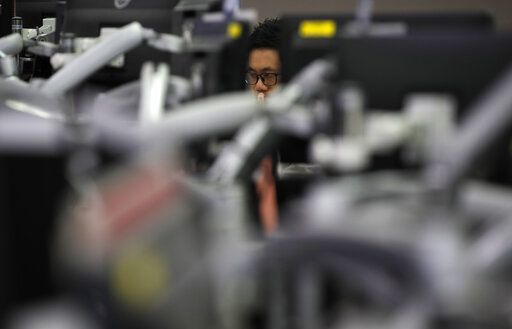 A currency trader watches computer monitors at the foreign exchange dealing room in Seoul, South Korea, Thursday, June 4, 2020.  Asian stock markets are mixed after Wall Street rose on better U.S. jobs and manufacturing data than expected.