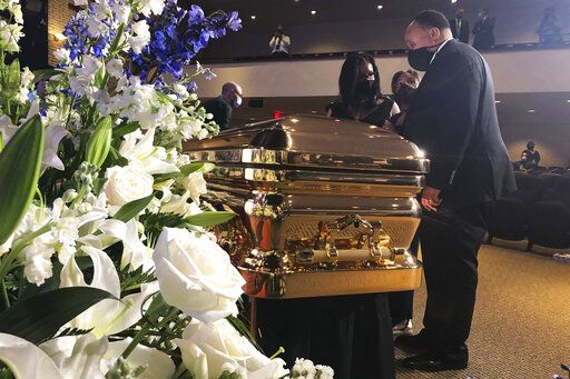 Martin Luther King III takes a moment by George Floyd's casket Thursday, June 4, 2020, before a memorial service for George Floyd in Minneapolis.