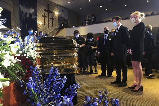 Minneapolis Mayor Jacob Frey, second from right, and First Lady Sarah Clarke, right pause before George Floyd's casket Thursday, June 4, 2020, before a memorial service for Floyd in Minneapolis.