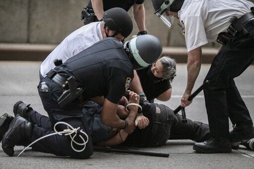 Police arrest a protester refusing to get off the streets during an imposed curfew while marching in a solidarity rally calling for justice over the death of George Floyd Tuesday, June 2, 2020, in New York. Thousands of demonstrators protesting the death of George Floyd remained on New York City streets on Tuesday after an 8 p.m. curfew put in place by officials struggling to stanch destruction and growing complaints that the nation's biggest city was reeling out of control night after night.
