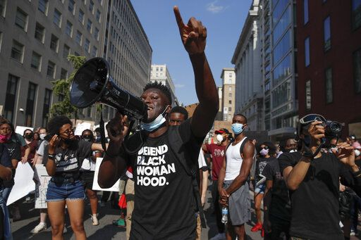 Demonstrators gather to protest the death of George Floyd, Wednesday, June 3, 2020, in Washington. Floyd died after being restrained by Minneapolis police officers.