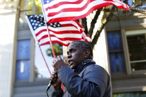 A protester demonstrates in and around Pioneer Square in Portland, Tuesday evening, June 2, 2020, following the death of George Floyd, a black man who died in police custody on Memorial Day in Minneapolis. (Sean Meagher/The Oregonian via AP)