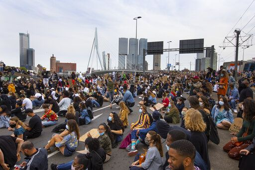 Thousands of people take part in a demonstration in Rotterdam, Netherlands, Wednesday, June 3, 2020, to protest against the recent killing of George Floyd, police violence and institutionalized racism. Floyd, a black man, died in police custody in Minneapolis, U.S.A., after being restrained by police officers on May 25, 2020.
