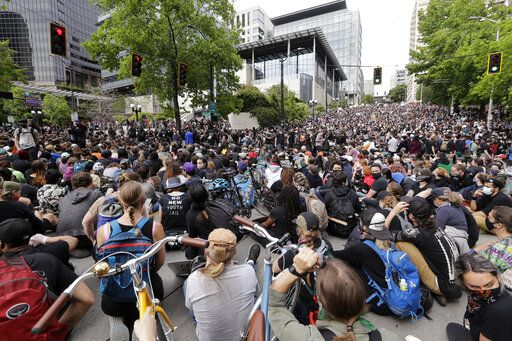 Peaceful protesters fill the intersection in front of Seattle City Hall Wednesday, June 3, 2020, in Seattle, following protests over the death of George Floyd, a black man who was in police custody in Minneapolis.