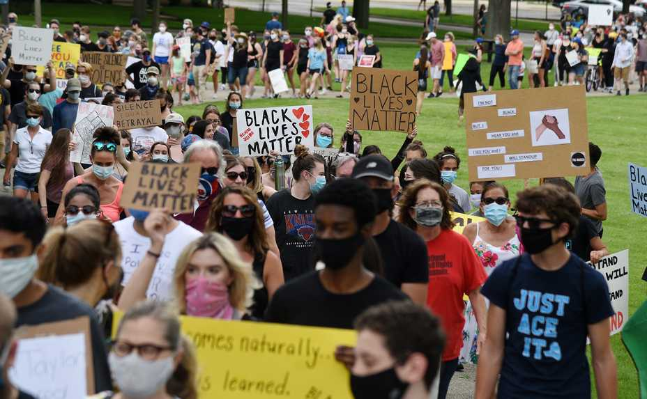 About 400 to 500 people march from South Middle School to North School Park in Arlington Heights Thursday to protest police brutality and support Black Lives Matter.