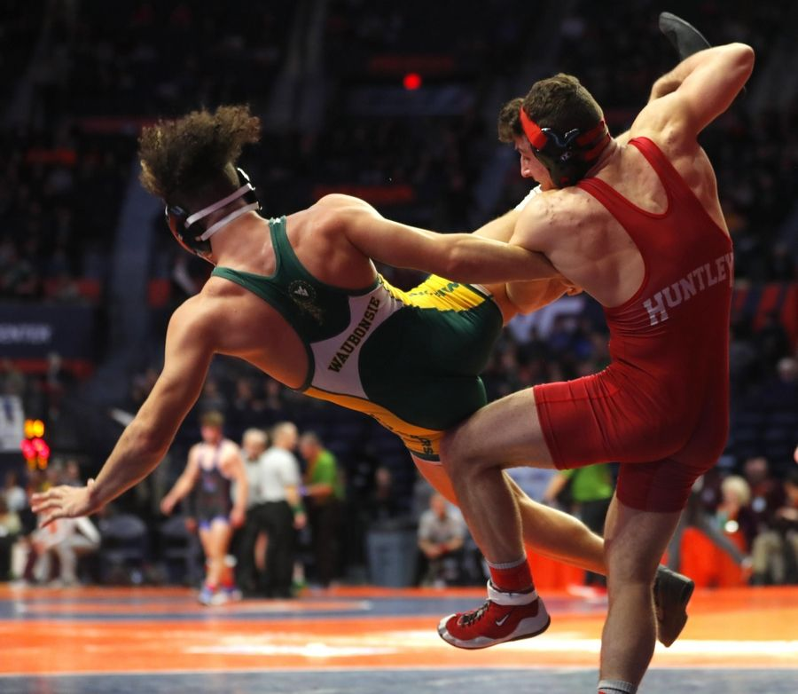 Huntley High School's David Ferrante throws Waubonsie Valley's Antonio Torres on his way to a state title in boys wrestling.