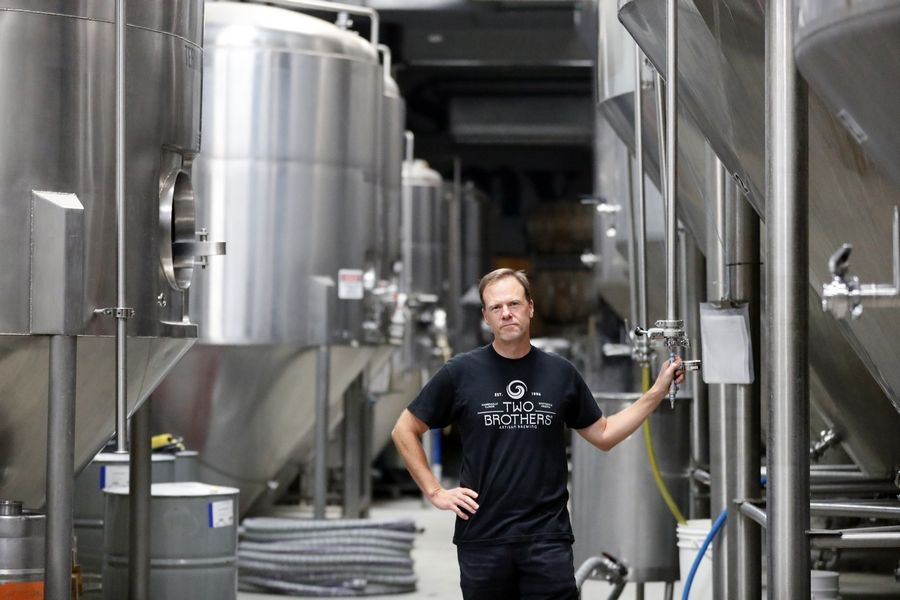 "Jason Ebel, co-founder of Two Brothers Brewing Company in Warrenville, said the family run business is ""facing a new reality now, so our businesses need to adjust and adapt as best they can."""