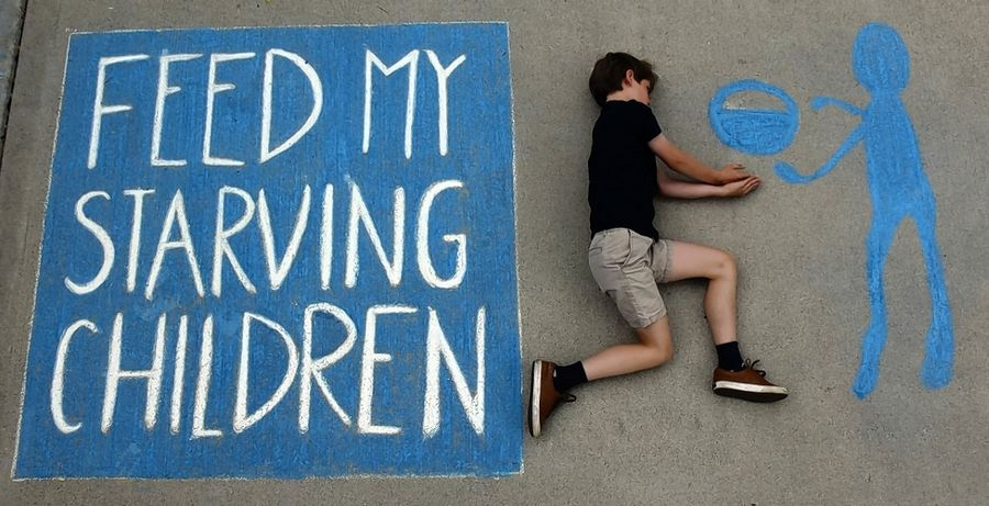 Macaire Everett, 14, of Libertyville has been creating daily chalk art on her family's driveway with her brother Camden as her model. This piece supports Feed My Starving Children in Libertyville.