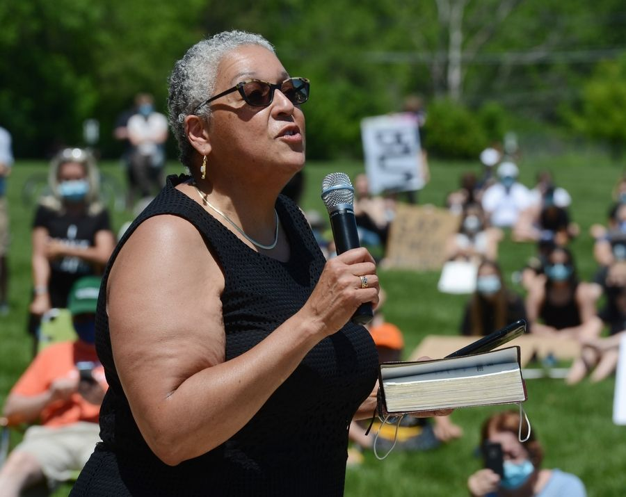 The Rev. Zina Jacque speaks during a protest supporting Black Lives Matter, held at Citizens Park in Barrington Saturday.