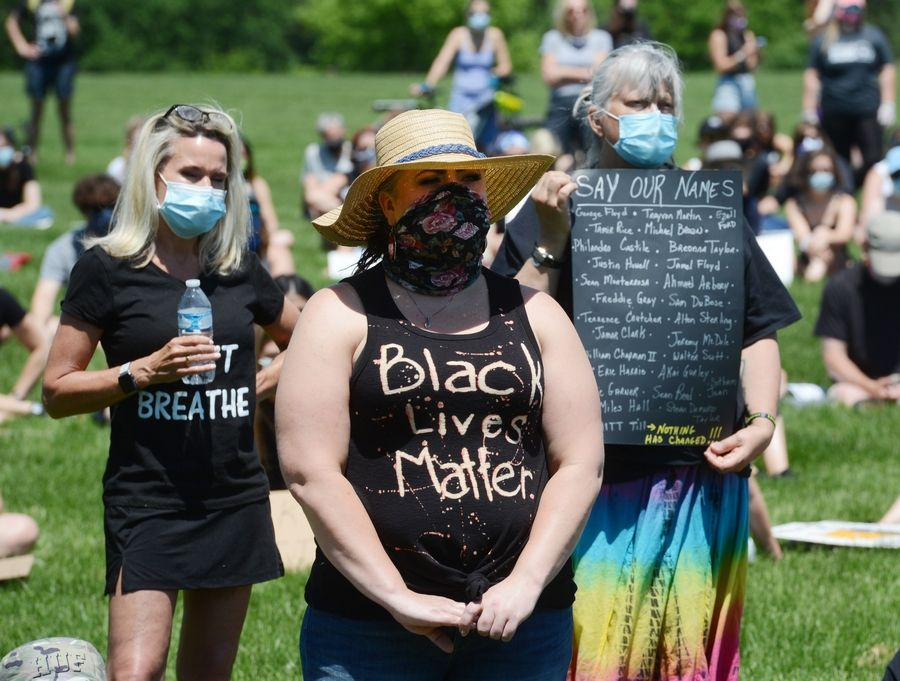Martina Hollinger, front, of McHenry attends a protest supporting Black Lives Matter, held at Citizens Park in Barrington Saturday.