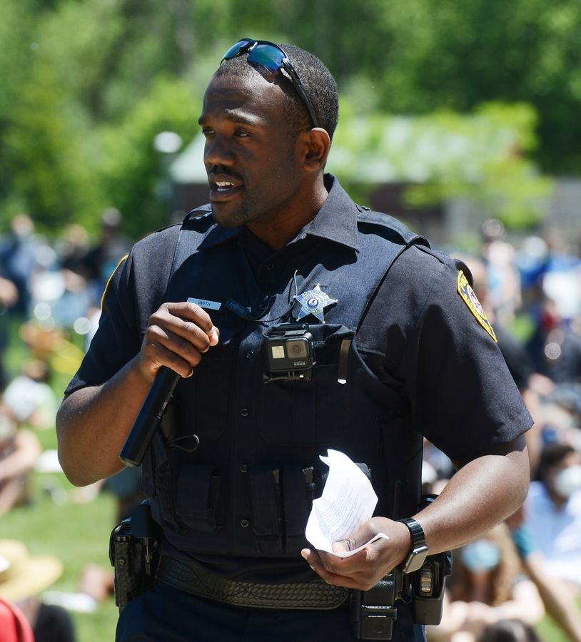 Hakeem Smith, the school resource police officer at Barrington High School, speaks during a protest supporting Black Lives Matter, held at Citizens Park in Barrington Saturday.