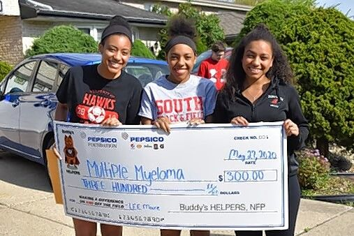 Three sisters from Park Ridge were recently honored by nonprofit organization Buddy's HELPERS for their efforts in promoting health awareness. From left are Julianna Moore, Sabrina Moore and Angelina Moore.