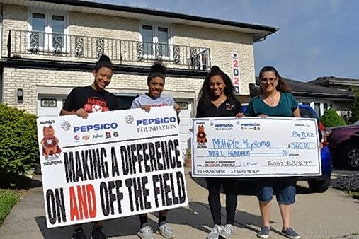 Three sisters from Park Ridge were recently honored by nonprofit organization Buddy's HELPERS for their efforts in promoting health awareness. The girls' father, Lee Moore, died from multiple myeloma in April 2019. From left are Julianna Moore, Sabrina Moore, Angelina Moore, and their mother, Paula Marie Moore.