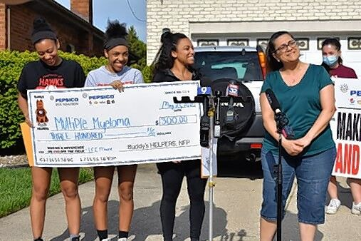 From left, Julianna Moore, Sabrina Moore, Angelina Moore, and their mother, Paula Marie Moore were honored for bringing awareness to multiple myeloma, which their father died from in 2019.