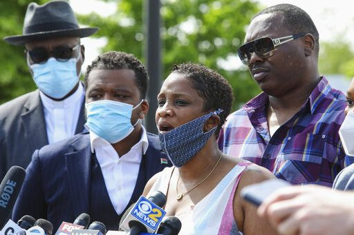 Kim Woods speaks with reporters in Chicago on Thursday, June 4, 2020. Several Chicago police officers are under investigation after a video surfaced showing them yanking women, including Woods, out of a car and throwing them to the ground in the parking lot of a shopping mall.