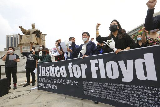 South Korean protesters stage a protest over the death of George Floyd, a black man who died after being restrained by Minneapolis police officers on May 25, near the U.S. embassy in Seoul, South Korea, Friday, June 5, 2020.