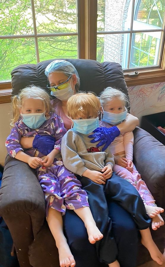 Naperville mom Maureen Dunne had to wear masks, surgical gloves, protective glasses and a hair net caring for her 3-year-old triplets at home. Even with rigorous protocols in place, health care experts were surprised that Dunne managed to avoid contracting the virus after nursing the toddlers back to health over a period of weeks.