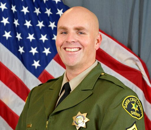 This photo provided by the Santa Cruz County Sheriff's Office shows Sgt. Damon Gutzwiller. Gutzwiller was shot and killed Saturday, June 6, 2020, in Ben Lomond, an unincorporated area near Santa Cruz, Calif., when he and two other law enforcement officers were ambushed by a suspect. (Santa Cruz County Sheriff's Office via AP)