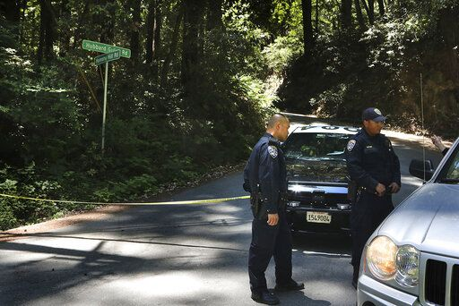 California Highway Patrol officers keep a road closed in Ben Lomond near Santa Cruz, Calif., Monday, June 8, 2020, as FBI agents continue processing the scene where Santa Cruz County Sheriff's Sgt. Damon Gutzwiller was killed Saturday. An active-duty U.S. Air Force sergeant accused of killing Gutzwiller in an ambush-style attack was a leader for a military base's elite security force, officials said Monday. Staff Sgt. Steven Carrillo has been arrested on suspicion of fatally shooting Gutzwiller and wounding two other officers Saturday. He is expected to be charged with first-degree murder. (Shmuel Thaler/The Santa Cruz Sentinel via AP)