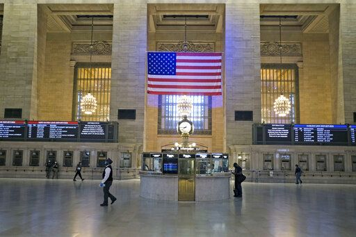 Commuter traffic is light during rush hour in Grand Central Station in New York, Monday, June 8, 2020. After three months of a coronavirus crisis followed by protests and unrest, New York City is trying to turn a page when a limited range of industries reopen Monday.