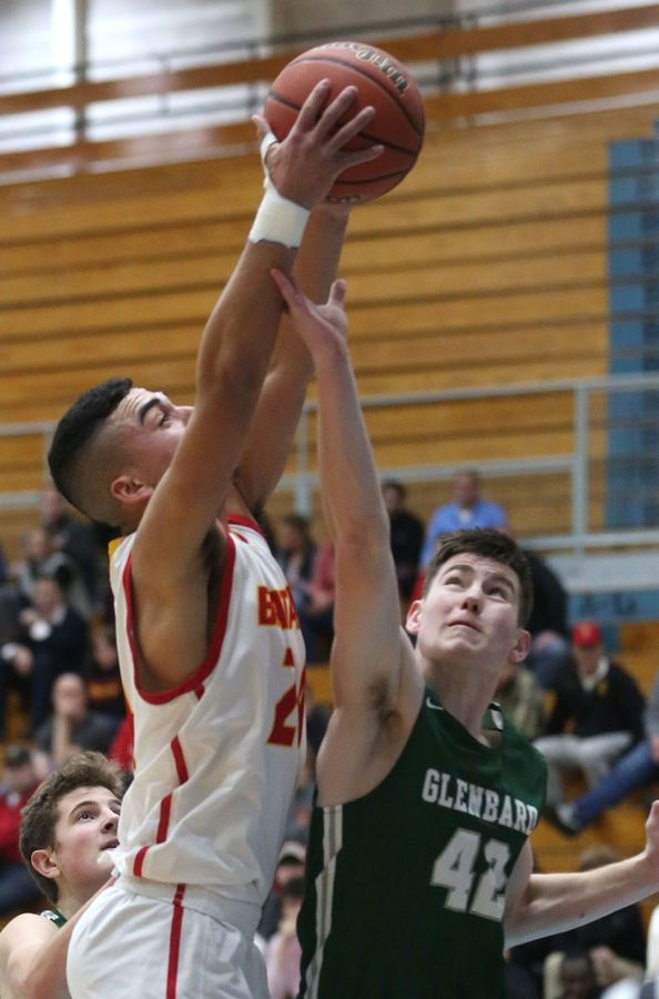 Glenbard West senior Colin Lewis (42) goes up for the rebound with Batavia's Jayden Johnson in a Class 4A Willowbrook boys basketball regional semifinal game.