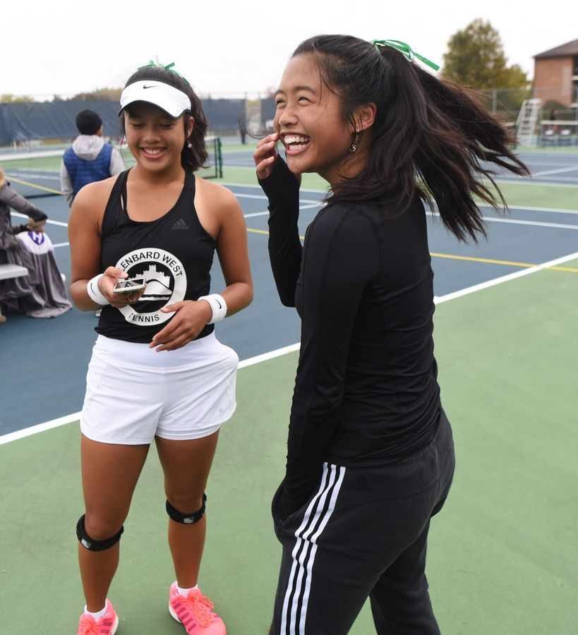 Glenbard West's Shannele, left, and Sienna Lopez celebrate their victory during the girls state tennis Class 2A doubles championship.