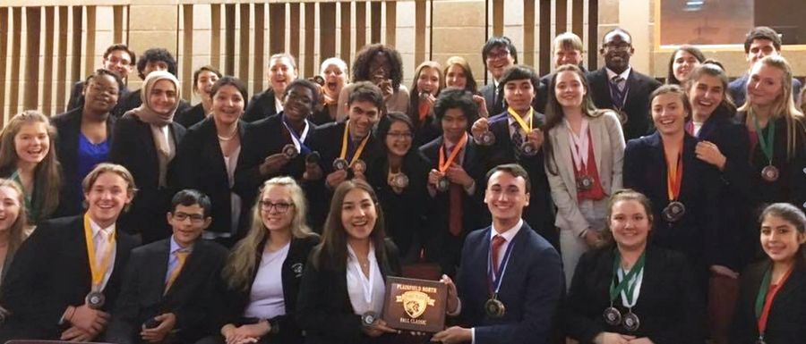 Hinsdale South High School students show off awards.