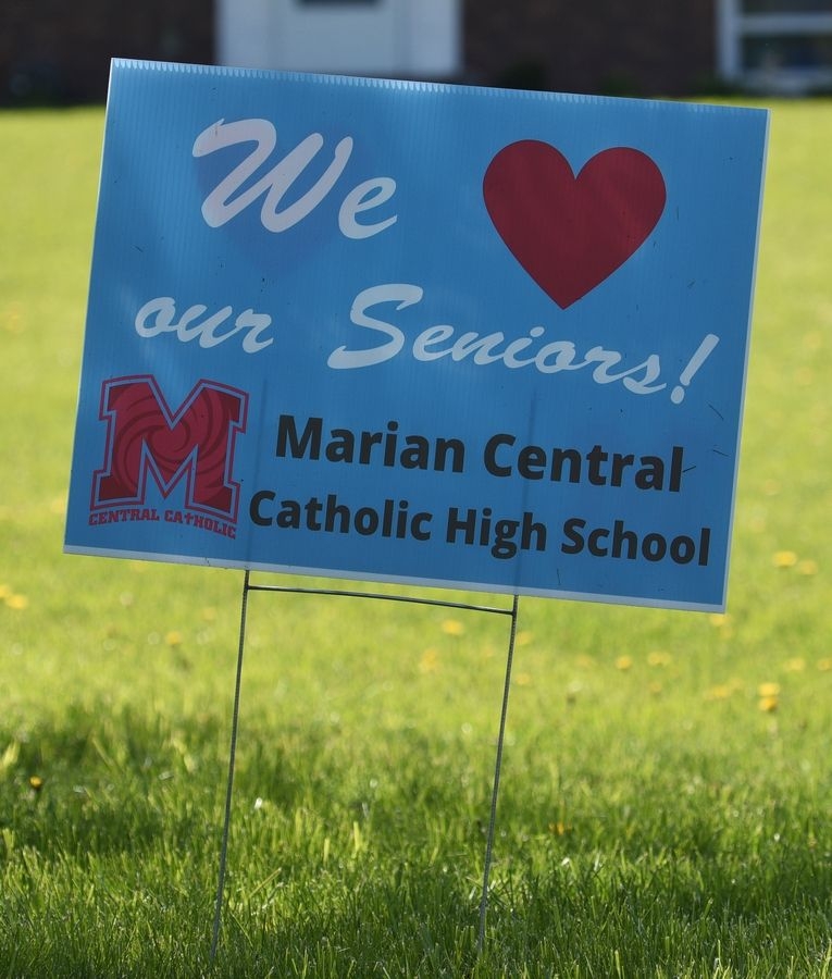 Marian Central Catholic High School 2020 senior graduation sign at a home on Doty Road near Woodstock.