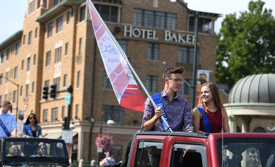 Class of 2020 royalty Patrick Overnesser and Nikole Custer ride through downtown during the St. Charles North Homecoming parade.