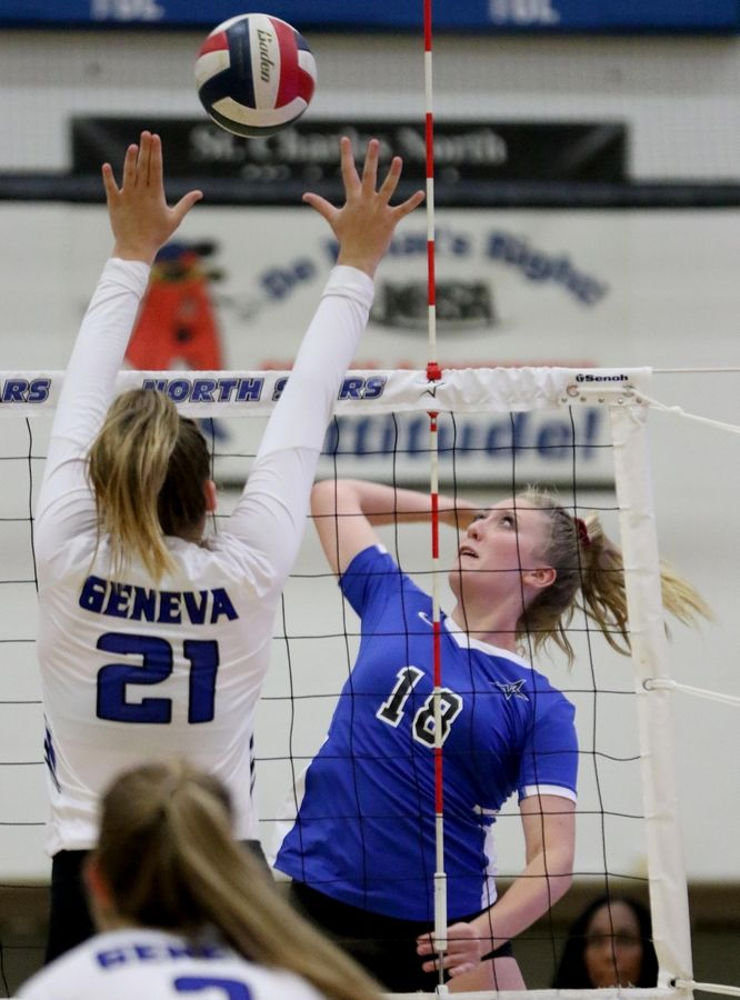 St. Charles North's Lauren Ringness prepares to hit the ball against Geneva during girls varsity volleyball action.