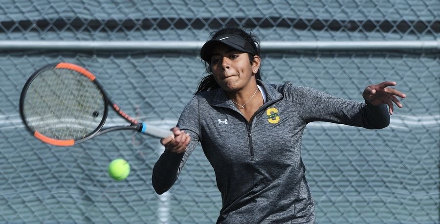Stevenson's Athena Kolli returns the ball during the girls state tennis doubles prelims at Rolling Meadows High School.