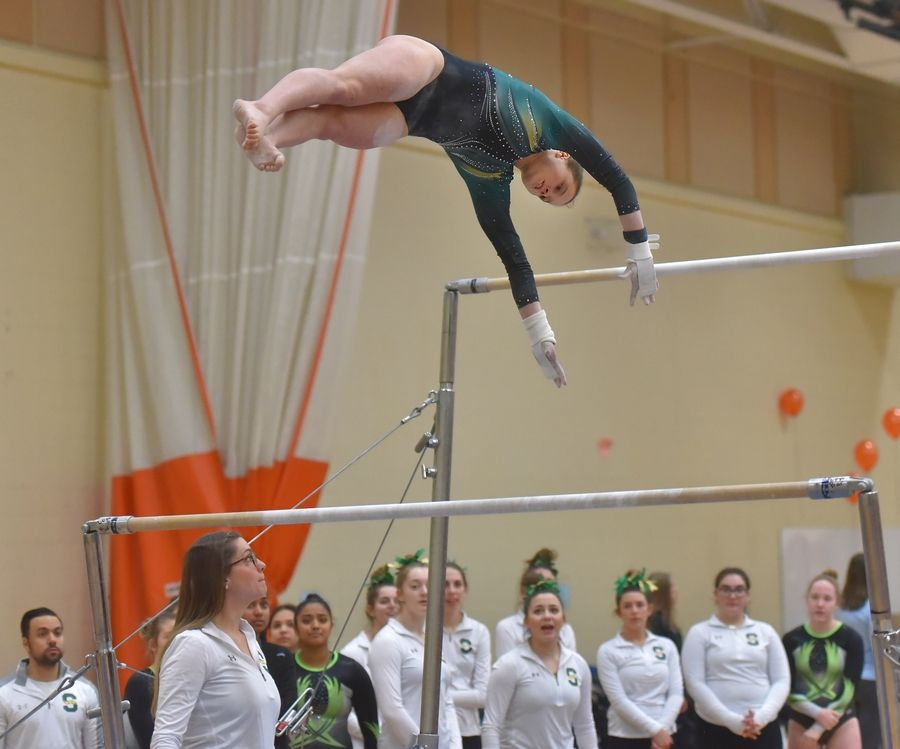 Stevenson's Emily Weinstein performs on the uneven bars in the North Suburban Conference girls gymnastics meet.