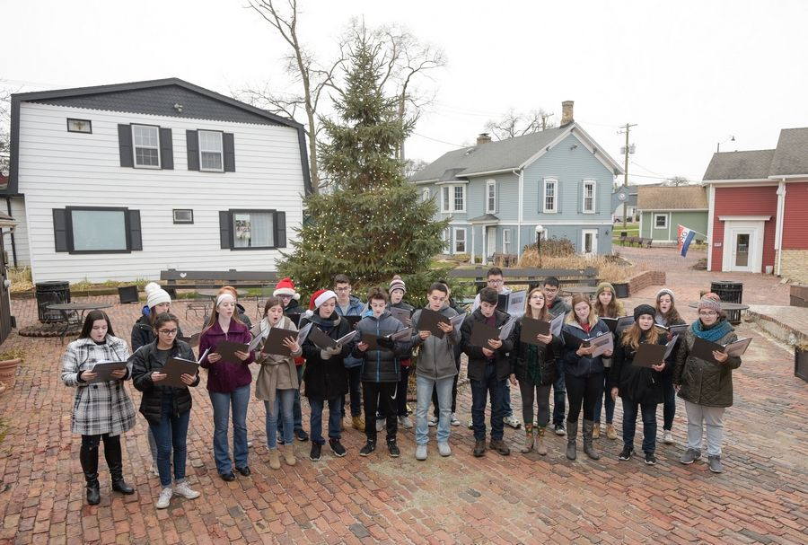 Members of the Buffalo Grove High School Choir sing carols in downtown Long Grove.