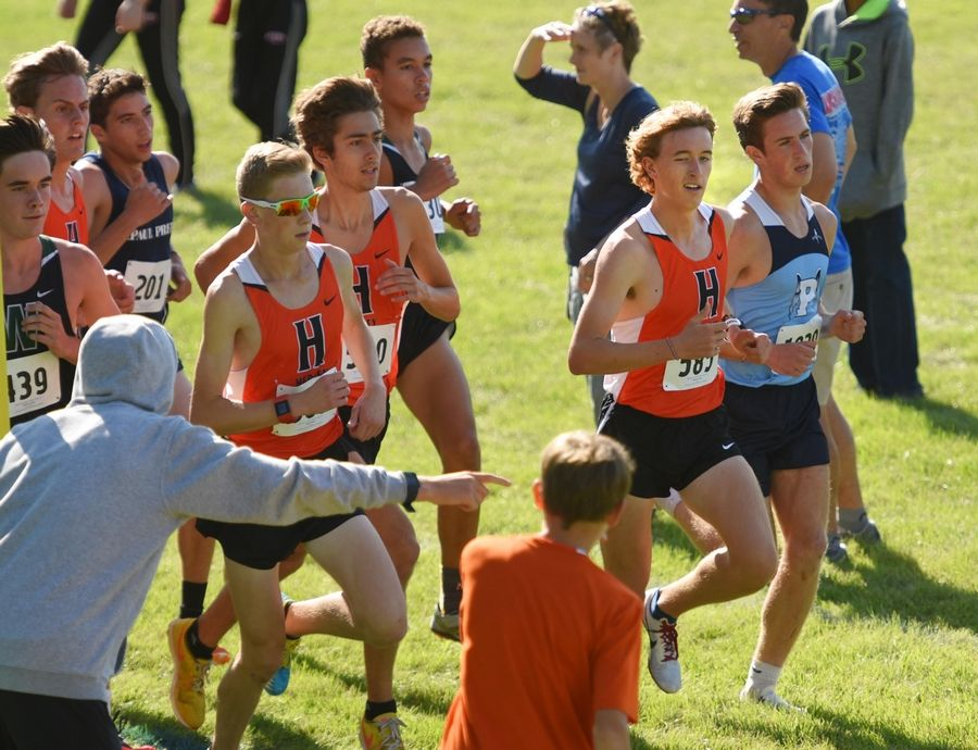Hersey's Josh Methner seems to wink at fans as he leads the Early Bird Invitational cross country meet at Fenton High School in Bensenville. He won the race by more than 12 seconds.