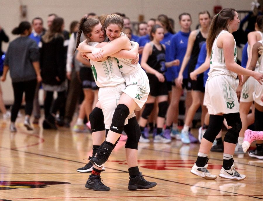 Sandy Bressner/Shaw Media IllinoisYork players Carley Schwartz and Sara Krissinger celebrate following a 47-39 Schaumburg Regional Final win over St. Charles North.